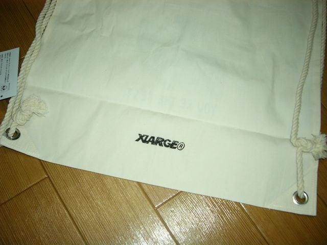 新品エクストララージXLARGE×ミッキーナップサック鞄DISNEY < ブランドの